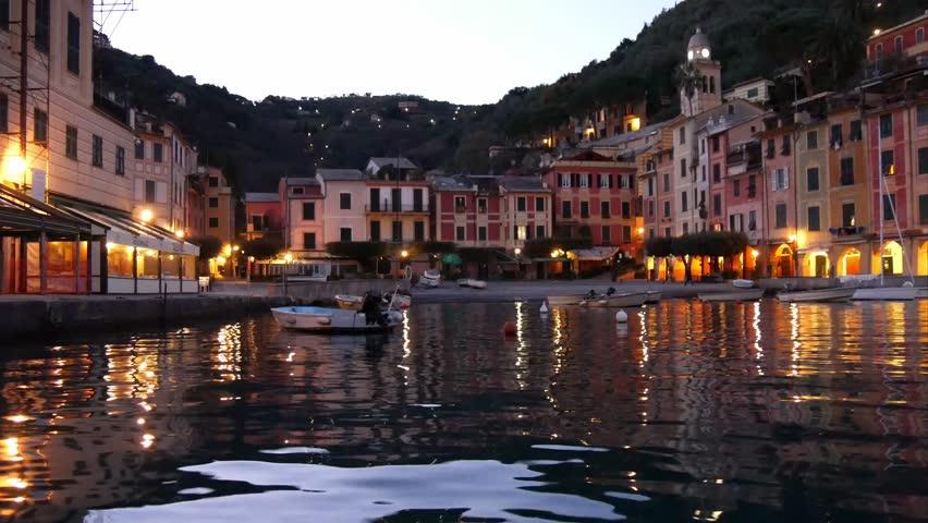 PORTOFINO, ITALY - CIRCA DECEMBER 2015:  the small harbor of Portofino at nightfall.  Portofino is a popular and typical seaside village of Liguria.   Shutterstock HD Video #14157914