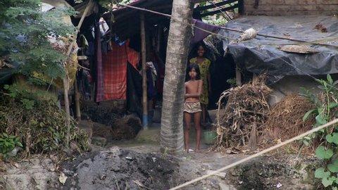 Baruipur, India - CIRCA 2013 - Indian children in jungle looking at camera