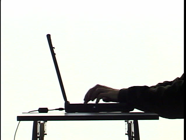typing on laptop in silhouette 1
