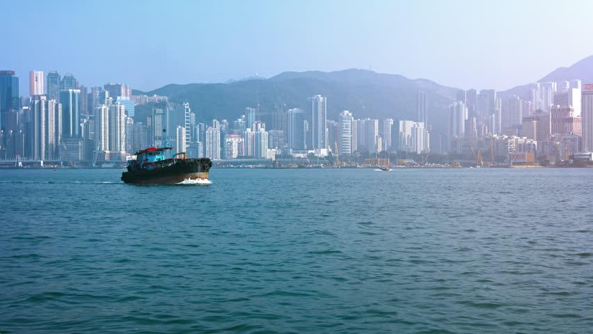 HONG KONG. CHINA - CIRCA JAN 2015: Tug boats and passenger ferry in Hong Kong's harbor. Video 4k | Shutterstock HD Video #14283064