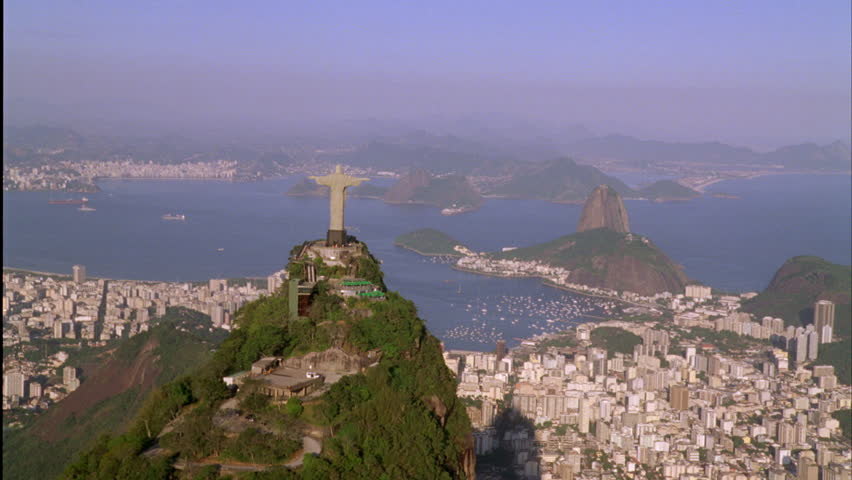 Oct 2008 - Rio De Janeiro, Brazil: helicopter aerial shot of Christ the Redeemer in Rio De Janeiro, Brazil with view of Corcovado mountain, Guanabara Bay, and Tijuca Forest National Park | Shutterstock HD Video #14326438