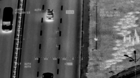 Traffic control surveillance footage. Flir thermal vision air drone shooting