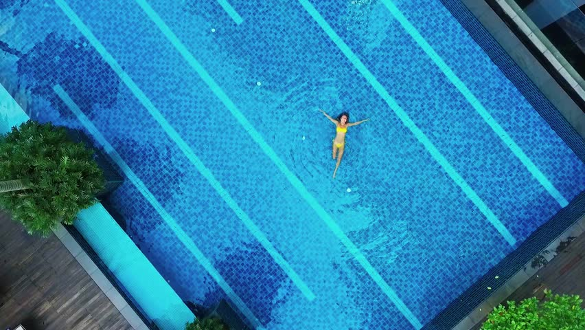 Aerial view of big swimming pool in private property.