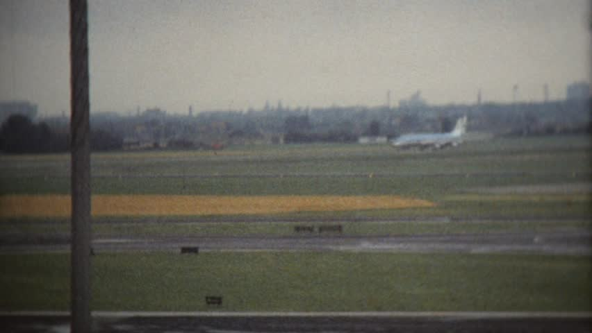 CIRCA 1968: Vintage 8mm film of airport
