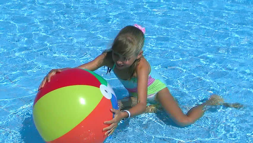 Pool Water With Beach Ball child playing beach ball in swimming pool. stock footage video
