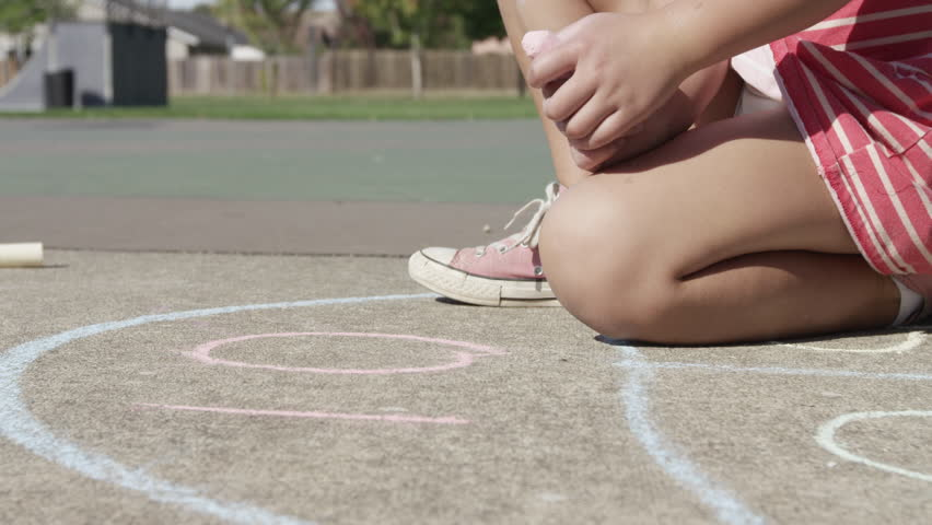 Young girl playing Hopscotch at park | Shutterstock HD Video #14489359