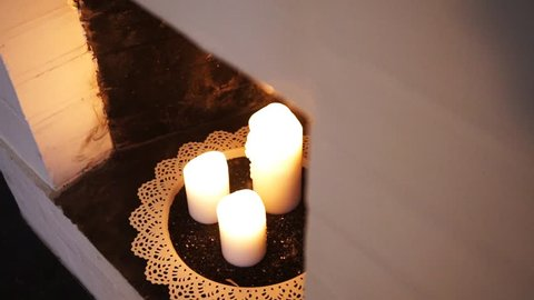 Cozy candels in the fire place.