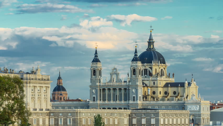 Madrid, Spain skyline timelapse at Santa Maria la Real de La Almudena Cathedral and the Royal Palace.