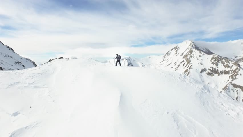 Aerial Flight Mountaineer Man Hiker Walking On The Edge Of Mountain Slope Swiss Alps Ridge Epic Achievement Accomplishment Concept | Shutterstock HD Video #14596543