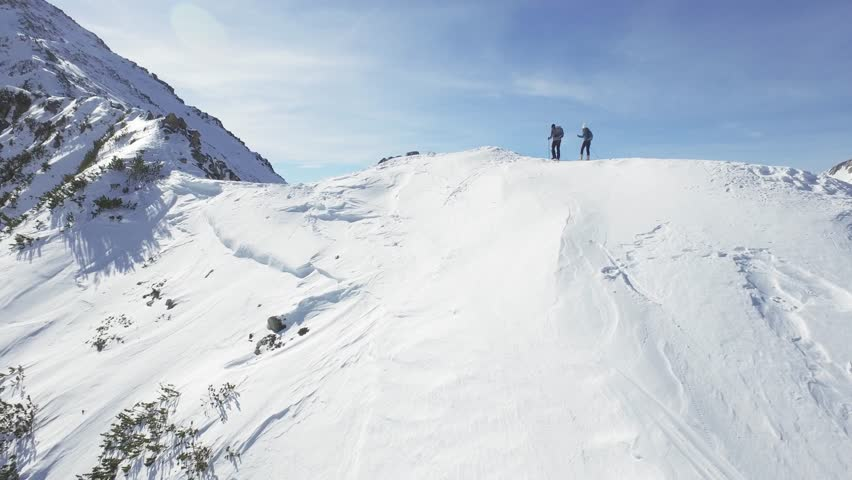 Man Woman Climbers Walking Up Winter Snow Mountain Slope Climbing Toward Peak Success Pursuit Challenge Exploration Everest Expedition Concept | Shutterstock HD Video #14596594