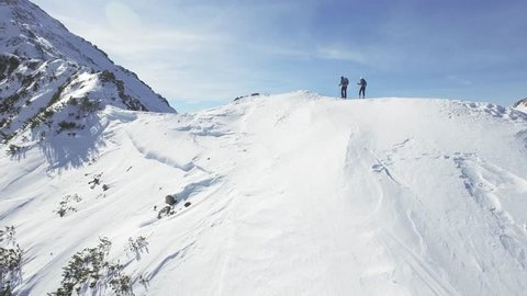 Man Woman Climbers Walking Up Winter Snow Mountain Slope Climbing Toward Peak Success Pursuit Challenge Exploration Everest Expedition Concept