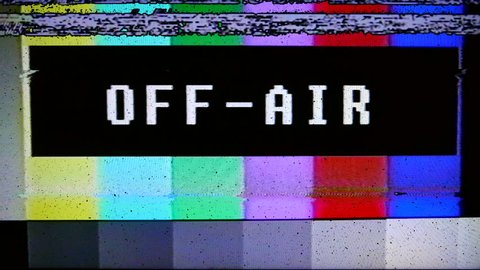 VHS Tape Color Bars Off-Air. Color bars test broadcast pattern with text off-air, static. All original elements manipulated on analog tape, captured with a 4K camera and assembled in Adobe Premiere.