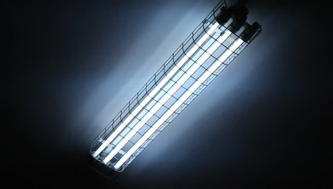 White fluorescent neon lighting turn on and off. Lighting neon lights on the ceiling. Neon glass tubes blinking and flashing white neon light.
