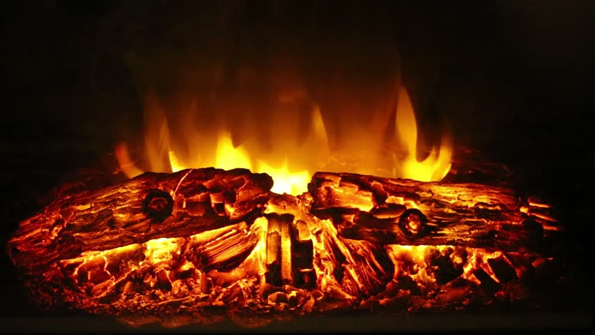 Closeup of burning flame and logs in electric fireplace | Shutterstock HD Video #14631304