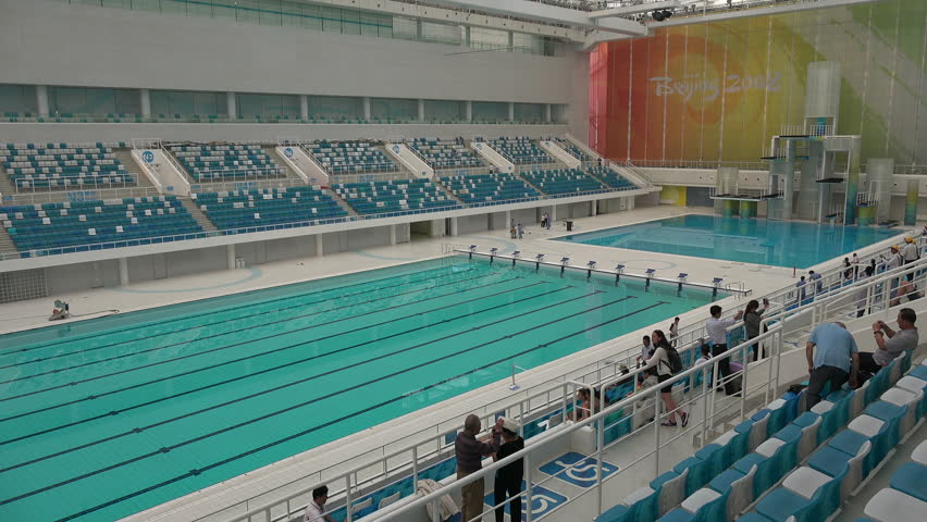 beijing china 14 september 2015 people visit the olympic swimming pool inside the water cube building in beijing stock footage video 14632174