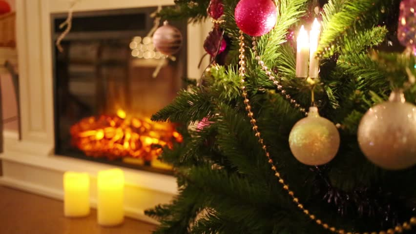 Beautiful Christmas Tree With Balls And Electric Fireplace Out Of Focus    HD Stock Video Clip