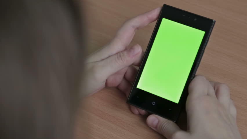 Female hands using cell phone, green screen #14650984