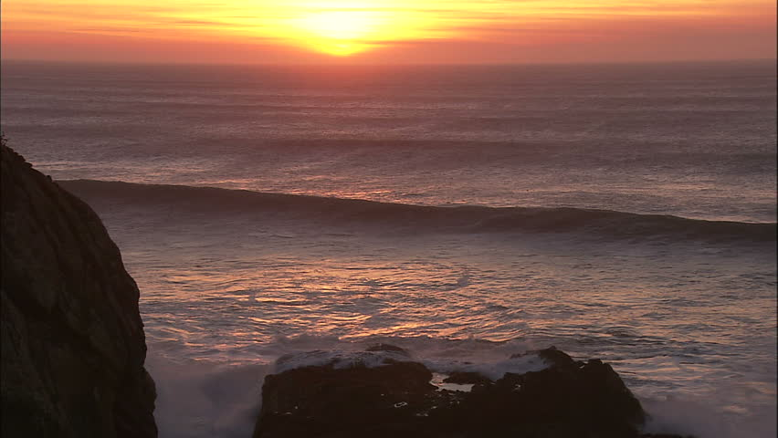 Pacific Coast Sunset With Large Rolling Waves and Mares Tails With Seals and