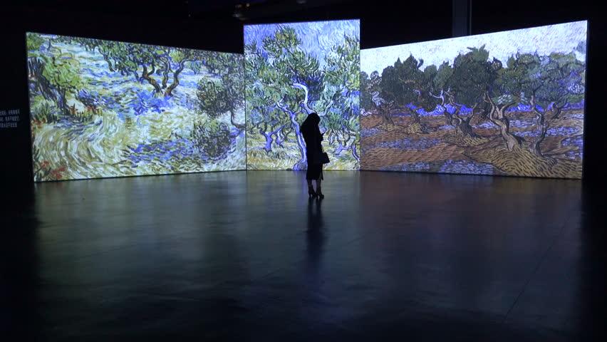 HANGZHOU, CHINA - 11 NOVEMBER 2015: Art gallery in China displays paintings of the Dutch master Van Gogh on large screens