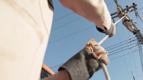 Energy workers adjusting powerline.