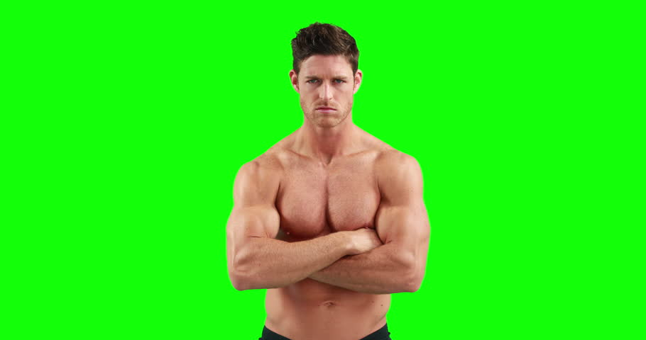 Muscular man with arms crossed against green background | Shutterstock HD Video #14688778
