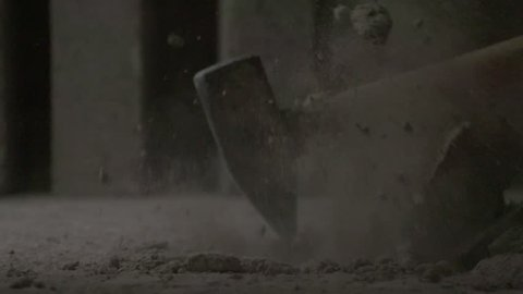 SLOW MOTION VIDEO FOOTAGE: Refurbishment of a floor tile with a big hammer