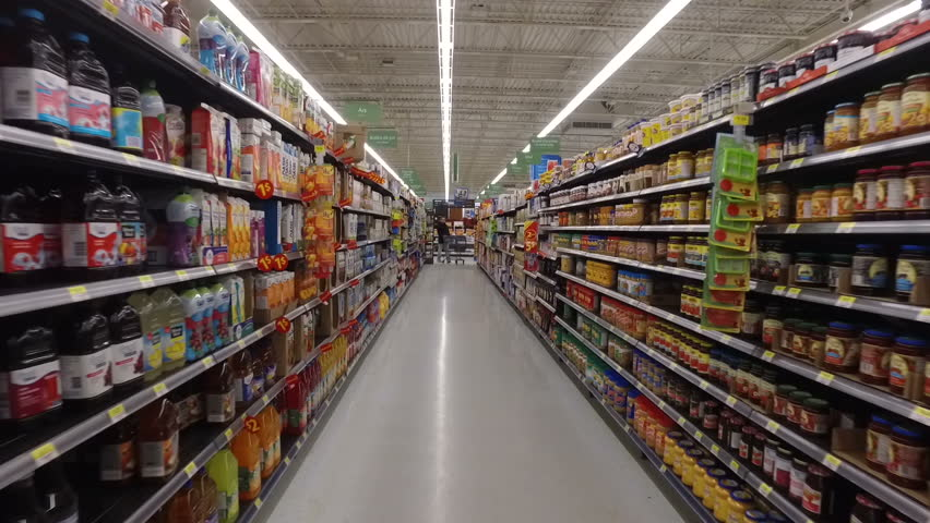 MONTREAL, CANADA - FEBRUARY 2016: Slow Motion: Walking through Walmart aisle (Juices, peanut butter, nutella, milk variety, cereal, tea, coffee)