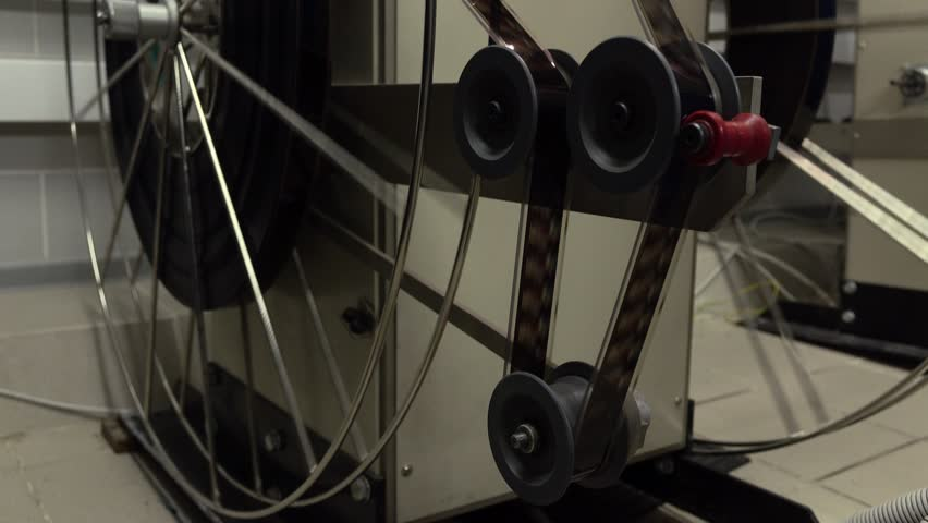 Close dolly video of moving parts in pro cinema projector, 4K video, part of set | Shutterstock HD Video #14699644