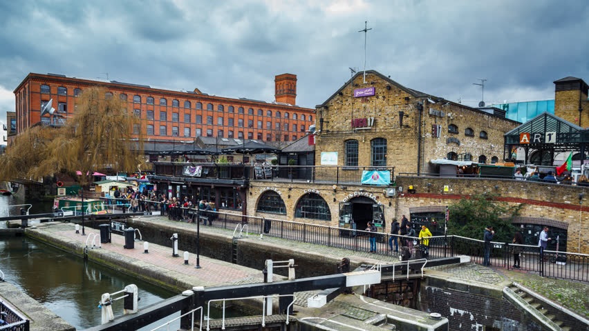 London, UK - FEBRUARY 19, 2016: Camden town Market Time Lapse with Boat. Boathouse crossing on the channel in Camden Town, London.