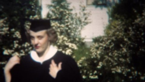 SAN FRANCISCO, CALIFORNIA 1949: College graduate in classic black and white gown and cap.