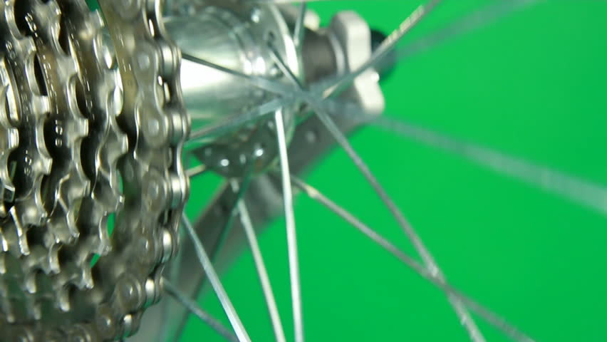 loop able clip rotating bicycle hub with gear, chain, wheel on green screen