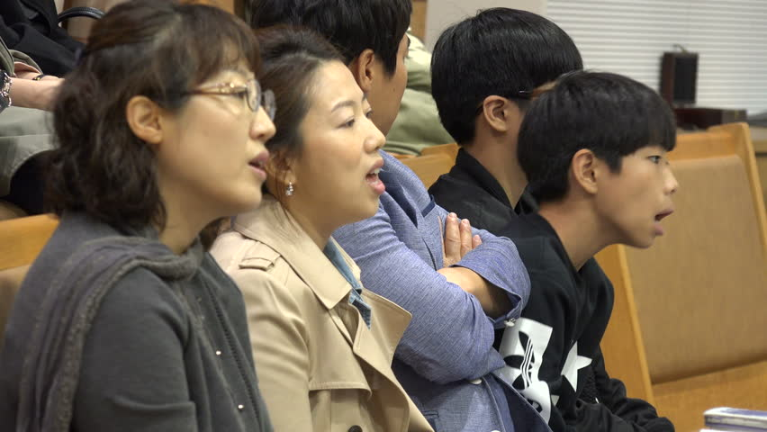 SEOUL, SOUTH KOREA - 11 OCTOBER 2015: A South Korean family attends a church mass in Seoul | Shutterstock HD Video #14742370