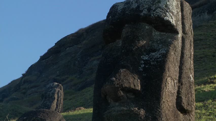Giant half carved faces stand at the quarry on Easter Island.