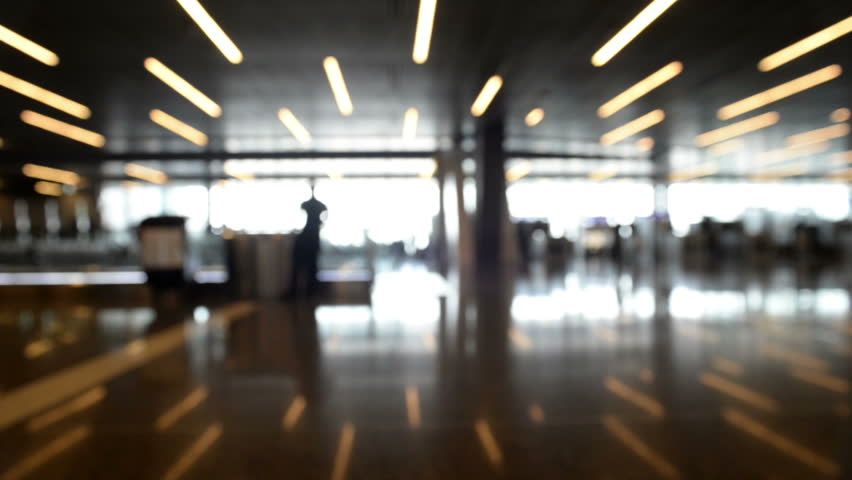 Defocused airport background, Silhouette People walking on the background.