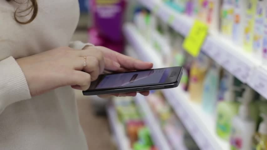 Woman Using the Phone in the Store | Shutterstock HD Video #14797711