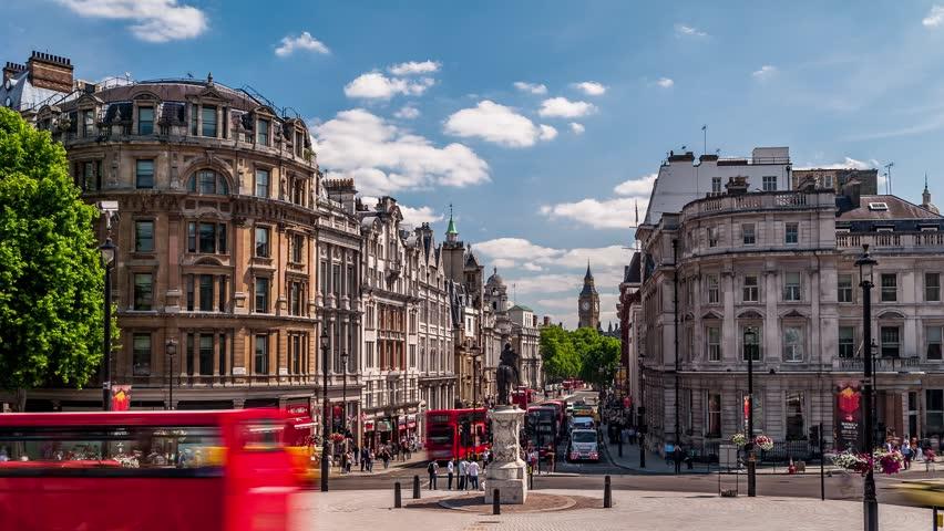 Traffic on Whitehall street by Trafalgar square in London, England