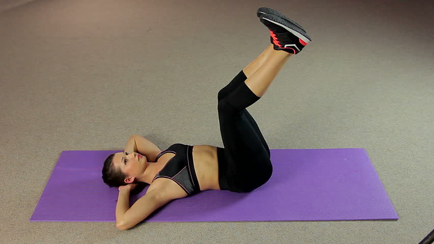 Young Female Lying On The Floor And Doing Fitness Exercise For Flat Belly  Stock Footage Video 14826244 | Shutterstock