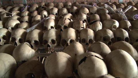 Thousands of skulls in long rows remember the genocide in Rwanda.
