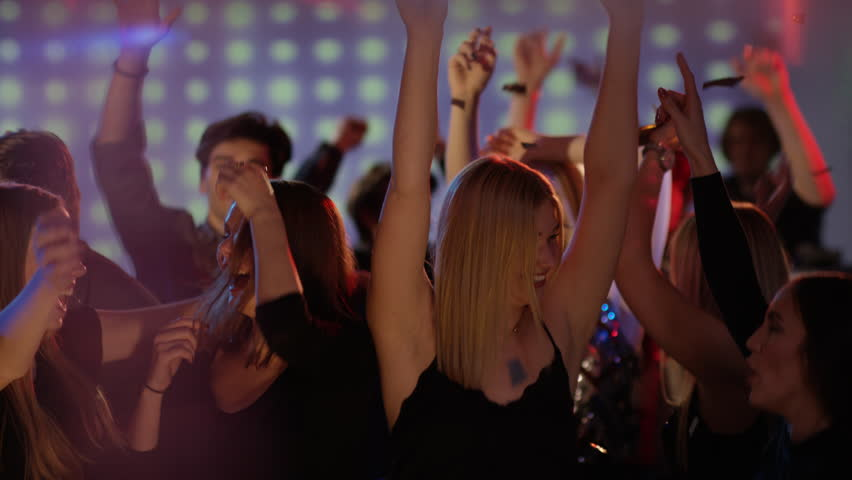 Young people celebrating New Year's Eve in club
