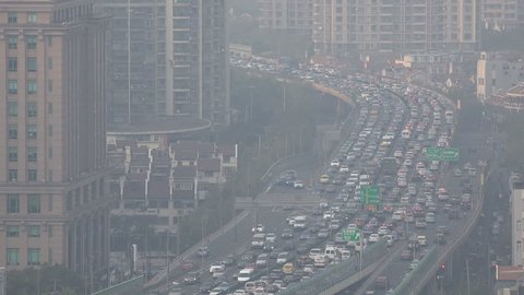 SHANGHAI, CHINA - 2 NOVEMBER 2015: Busy traffic during rush hour in central Shanghai, air pollution and smog, city center, urban China
