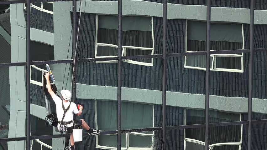 AUCKLAND - MAR 02 2016:Window Cleaner Works On High Rise Building ...