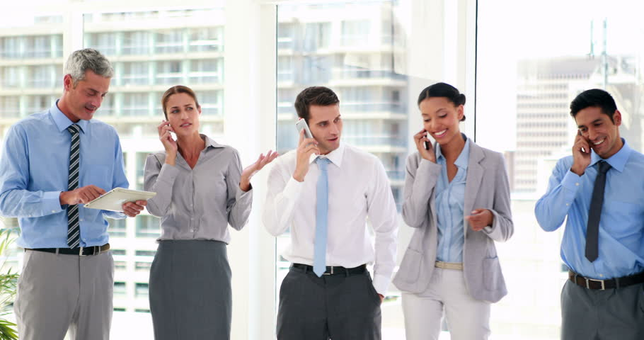 HD video of business people having phone call and using tablet computer | Shutterstock HD Video #14956375