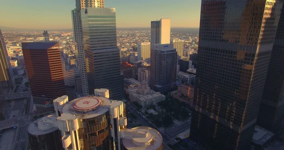LOS ANGELES: - Circa 2015: Aerial view of downtown Los Angeles skyline skyscrapers. Camera flying backward. 4K UHD.
