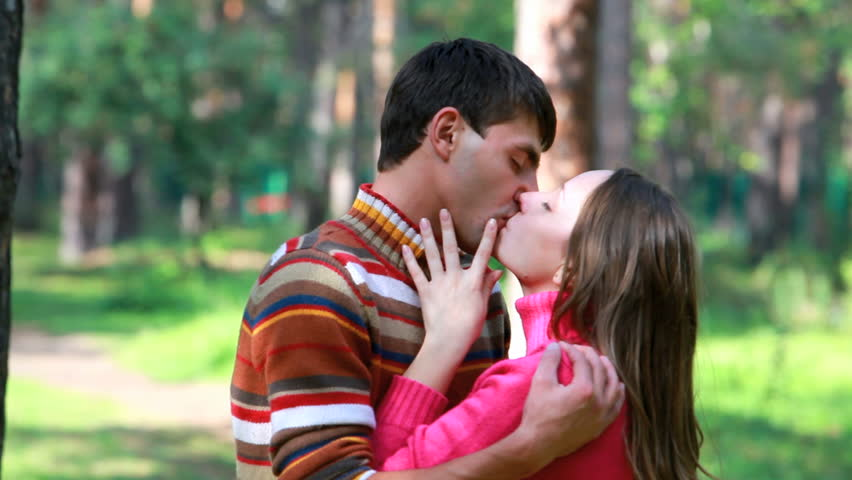 Young passionate couple kissing outdoors
