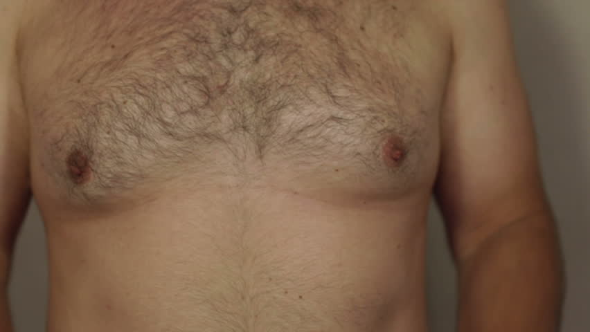 Closeup of corpulent male hairy chest. | Shutterstock HD Video #14985664