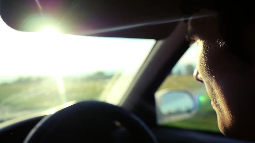 Man driving the car under sunset sky at outdoor in slowmotion. Summer time. 1920x1080 | Shutterstock HD Video #14993863