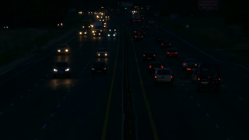 Ungraded: Highway at Night / Highway Road / Highway Traffic. Cars driving on a six-lane highway with head-lights turned on. Source: Lumix DMC, ungraded H.264 from camera. (av25753u)