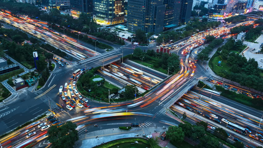 4K video(zoom in): Aerial View of freeway busy city rush hour heavy traffic jam highway. Timelapse of driving & cars racing by with streaking lights trail at night. | Shutterstock HD Video #15014554