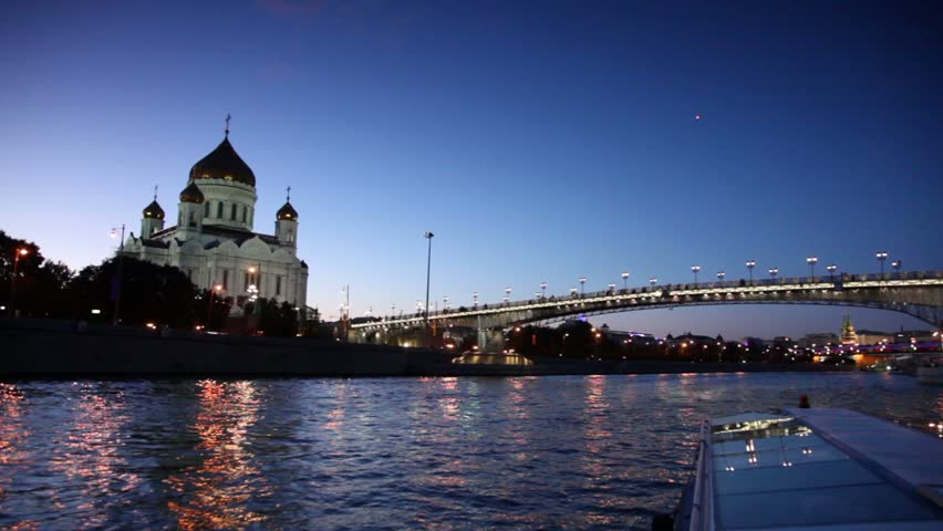 Ship sail down the river, Christ Savior Cathedral and Patriarchal Bridge at evening in Moscow, Russia