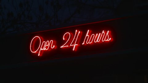Illuminated Sign Open 24 Hours, Red Figures on a Black Background, Red Glowing Elements, Hour Sign, Night City, Capital Letters, Type Directly